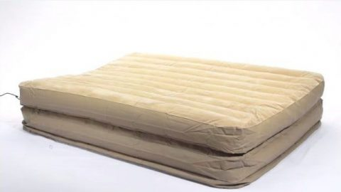 A deflated Air mattress that's beige and is losing consistent air