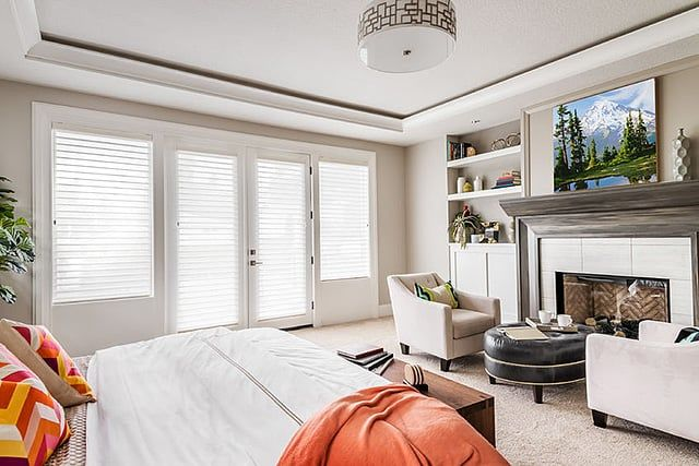 give your master bedroom a beautiful sitting area right in front of the fireplace simple armchairs and an elegant leather ottomantable make for the ideal - Master Bedroom Sitting Area