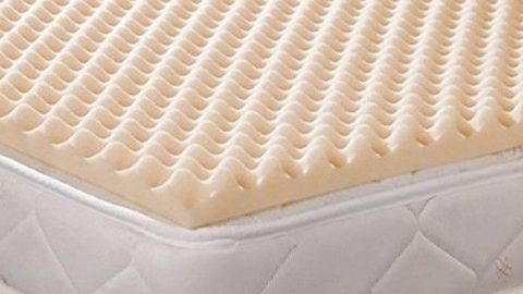 Image of convoluated foam on top of a mattress