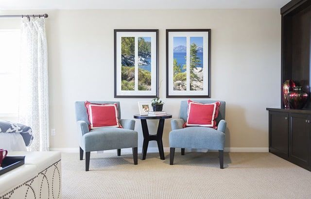 Who Says You Cant Have A Nice View Without Being Able To Look Outside This Sitting Area Features Two Comfy Armchairs With Couple Of Decorative Pillows