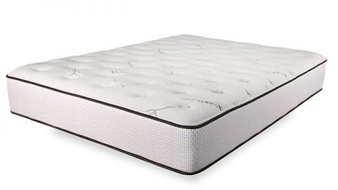A dreamcloud mattress in a whited out background
