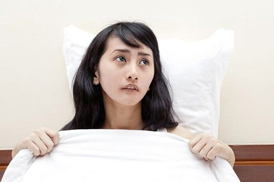Young girl stressed and unable to sleep.