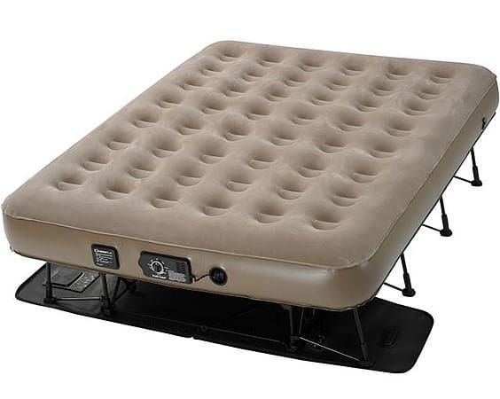 a brown instabed airmattress on black stands that's been pumped up.