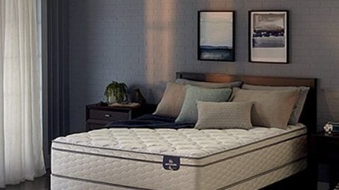 Eurotop innerspring mattress on display with a bed frame and in a staged room