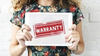 a girl holding an ipad that says warranty