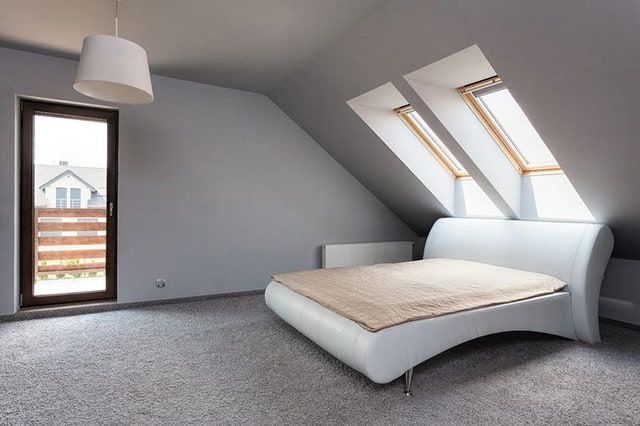 This very simple stripped back loft renovation bedroom couldnt get much more bare but this is massively to the advantage of the room