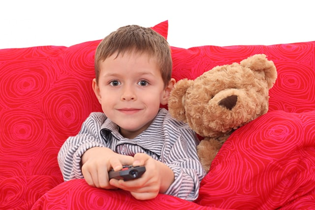 little boy and bear in bed