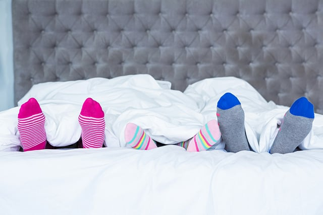 wearing socks to bed compelling reasons to cover your tootsies each night the sleep judge. Black Bedroom Furniture Sets. Home Design Ideas