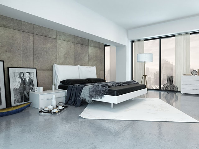 This Is About As Modern As You Can Get It. This Room Has A Beautiful  Concrete Floor With A Very Elegant Area Rug. Behind The Bed Is A Large  Paneled Wall, ...