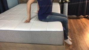 jess testing edge support for the mattress closer to the middle