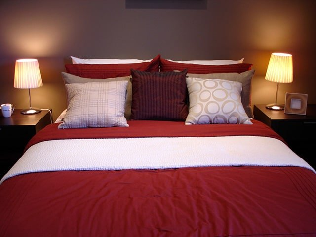 Brown And Red Bedroom Ideas Part - 41: This Rose Red Comforter With The White Accent Absolutely Brightens Up The  Room. Those Brown Walls And Brown Nightstands Are Colored ...