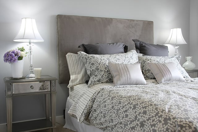 There Is A Lot Of Grey In This Room As You Can See The Headboard Made With Beautiful Upholstery That Resembles Velvet Walls Are Light