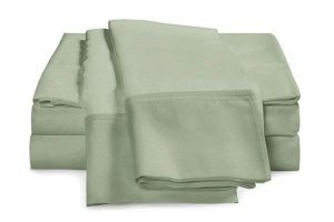 Tan eluxury supply sheet set that's tan colored and folded nicely on top of each other