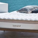 Bed with Loom & Leaf mattress by the water.