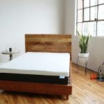 Image of a bear mattress in a well lit staged room with hardwood