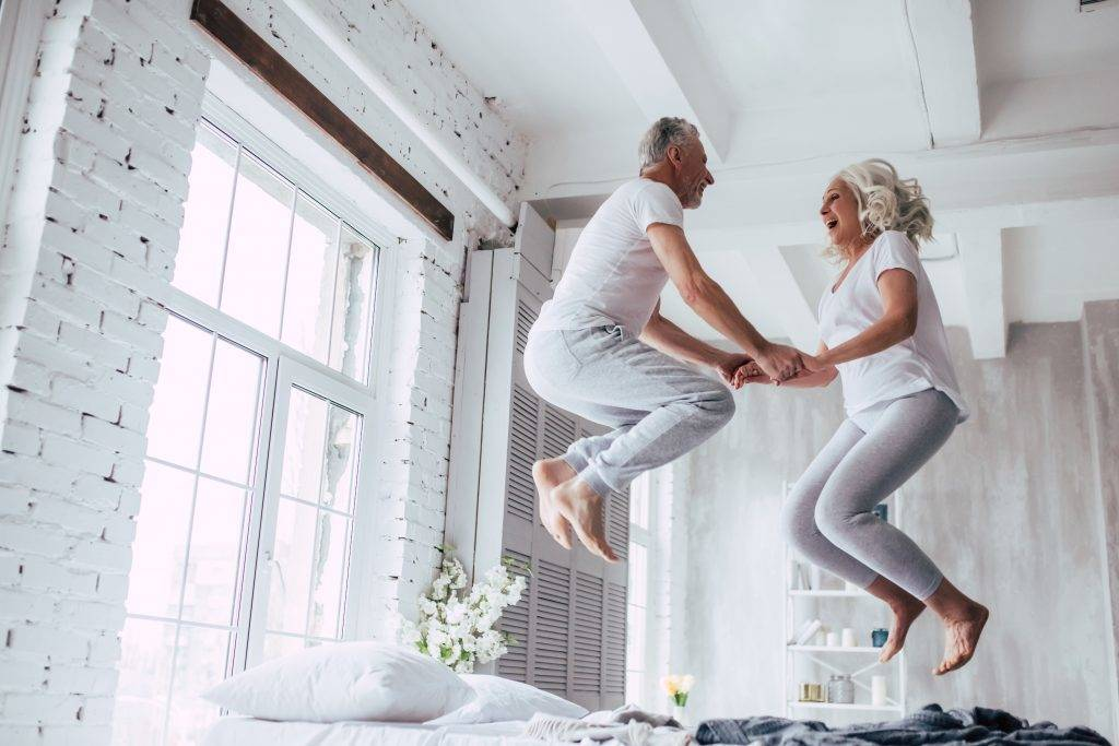 couple jumping on the bed