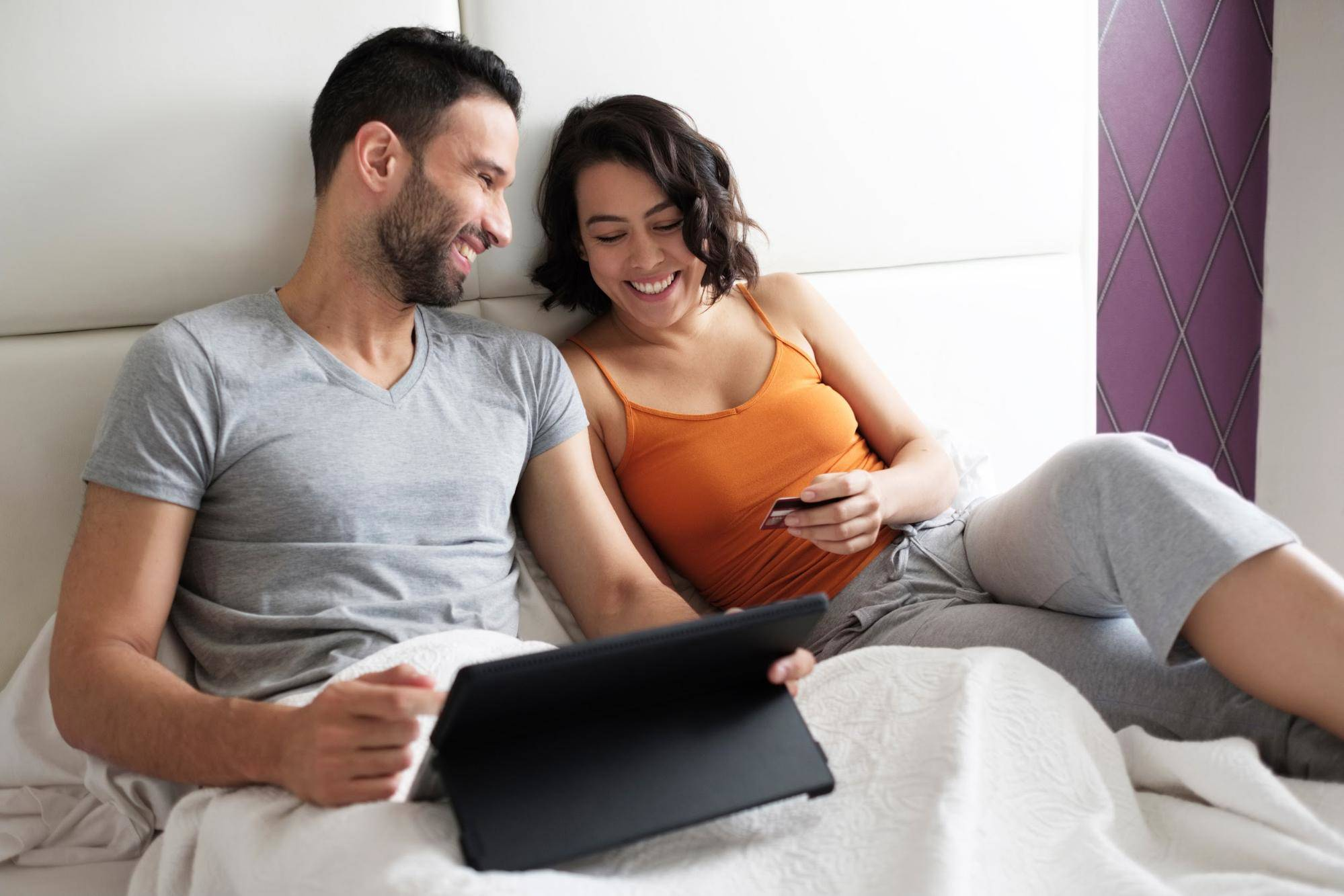couple sitting in bed together